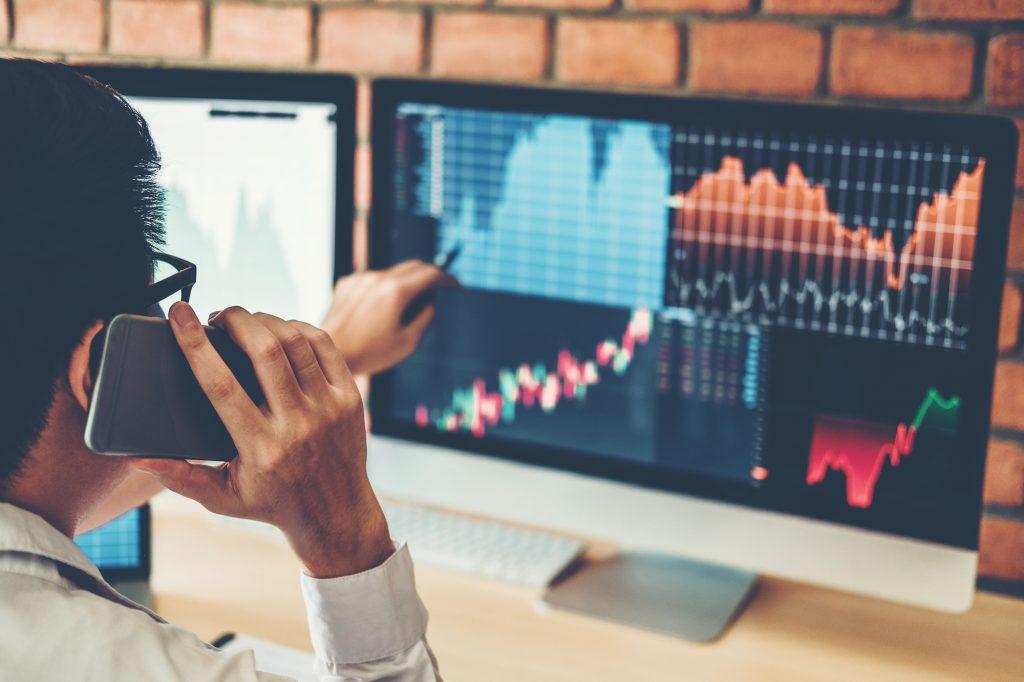 mortgage portfolio buyer looking at computer