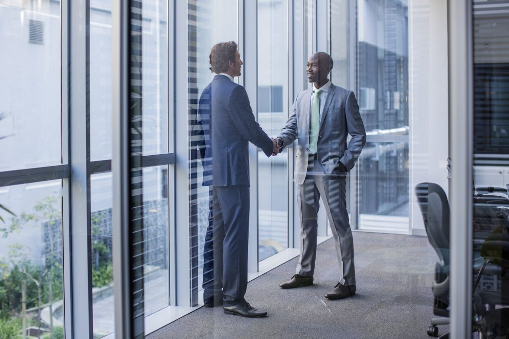 two men shaking hands on a mortgage loan for securitizers